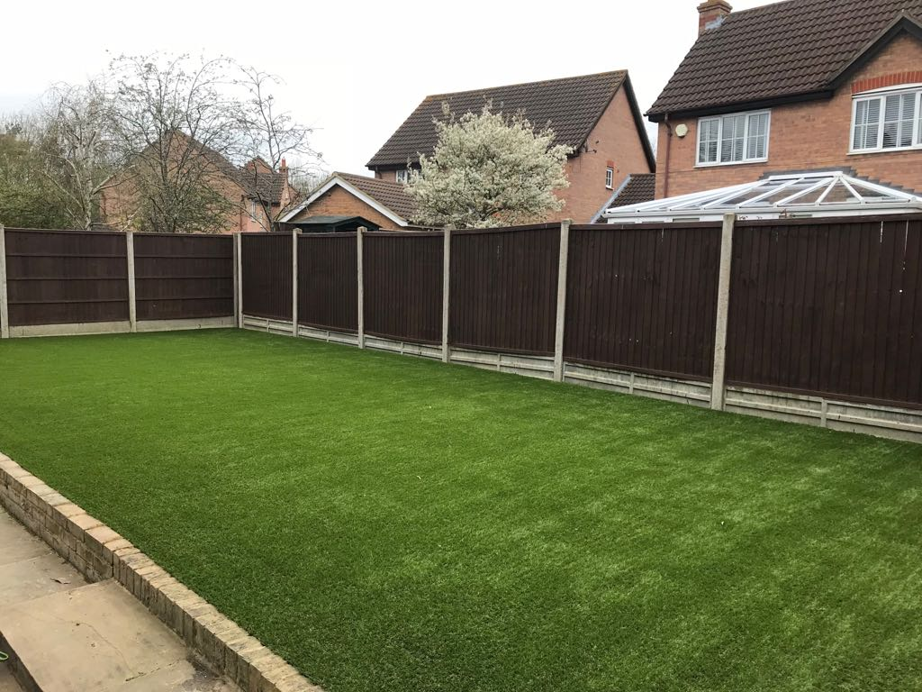 Back garden artificial grass install Goldington